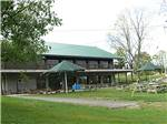 View larger image of Camping cabins with red roofs at BISSELLS HIDEAWAY RESORT image #6