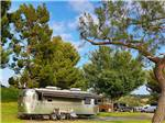 View larger image of An Airstream RV parked under the trees at BONELLI BLUFFS RV RESORT  CAMPGROUND image #2