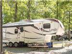 View larger image of Trailers parked in sites alongside dirt road at KETTLE CAMPGROUND CABINS  RV PARK image #5