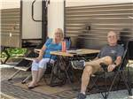 View larger image of The playground with a tree in front at KETTLE CAMPGROUND CABINS  RV PARK image #7