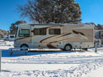 View larger image of A Class A motorhome parked in snow at GRAND CANYON TRAILER VILLAGE RV PARK image #4
