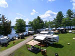 View larger image of Boats docked and trailers camping on lake at AUGUSTA-WEST LAKESIDE KAMPGROUND image #3