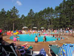 View larger image of People enjoying the pool at HAYWARD KOA image #9
