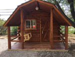 View larger image of Log cabins with decks at MOORES RV PARK  CAMPGROUND image #4