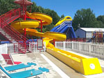 View larger image of Water slides and outdoor seating at QUIETWOODS SOUTH CAMPING RESORT image #5