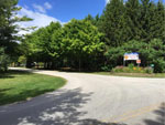 View larger image of Gravel road and welcome sign at QUIETWOODS SOUTH CAMPING RESORT image #9