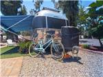 View larger image of A bike sitting in front of a trailer at CIRCLE RV RESORT - SUNLAND image #2