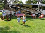 View larger image of Family camping in RV at BETHPAGE CAMP-RESORT image #2