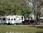 View larger image of Trailers camping on the water at LONE STAR JELLYSTONE PARK image #6