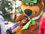 View larger image of Yogi Bear with kid at LONE STAR JELLYSTONE PARK image #7
