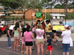 View larger image of Yogi Bear character signing autographs for children at LONE STAR JELLYSTONE PARK image #9