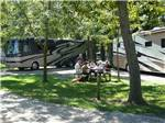 View larger image of Two empty wooden chairs on the beach at CAMPERS COVE CAMPGROUND image #4