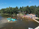 View larger image of Aerial view of people enjoying the lake at EVERGREEN CAMPSITES  RESORT image #1