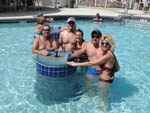 View larger image of Group of adults with beverages in the pool at EVERGREEN CAMPSITES  RESORT image #2