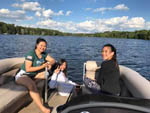 View larger image of Three young women in a boat on the lake at EVERGREEN CAMPSITES  RESORT image #5