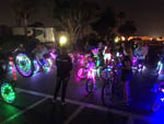View larger image of Kids biking with neon lights on their bikes at CHULA VISTA RV RESORT image #3