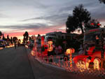 View larger image of RVs parked in sites decorated with Christmas lights and decorations at CHULA VISTA RV RESORT image #12