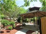 View larger image of Patio area with table at RANCHO LOS COCHES RV PARK image #4