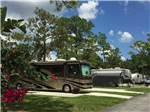 View larger image of RVs and trailers parked on paved sites surrounded by grass at WEST JUPITER RV RESORT image #3