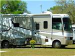 View larger image of A fifth wheel RV with a patio attached to it at SOUTHERN AIRE RV RESORT image #8