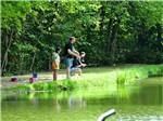 View larger image of Family fishing at PINCH POND FAMILY CAMPGROUND image #6