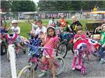 View larger image of Kids biking at PINCH POND FAMILY CAMPGROUND image #12