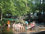 View larger image of Campers enjoying the river at MOUNTAIN CREEK CAMPGROUND image #2