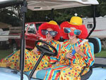 View larger image of Campers dressed as clowns in golf cart at MOUNTAIN CREEK CAMPGROUND image #10