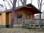 View larger image of Large front deck of log cabin at MARVAL RESORT image #9