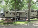 View larger image of BBQ and picnic area beside trailer at ROUGHRIDER CAMPGROUND image #5