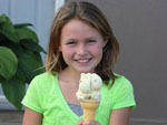 View larger image of Kid eating ice-cream at PINE HILLS RV PARK image #3