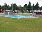 View larger image of Swimming pool with outdoor seating at PINE HILLS RV PARK image #6