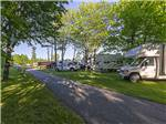 View larger image of A shady road alongside of RV sites at CAMPING TRANSIT image #1