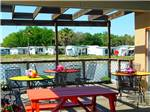 View larger image of A sitting area with a picnic bench at PALM VIEW GARDENS RV RESORT image #8