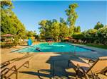 View larger image of People swimming in the pool at VINEYARD RV PARK image #1