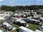 View larger image of Well groomed stalls with trailers backed into them at QUAIL RUN RV RESORT image #2