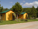 View larger image of Cabins with picnic tables at CROOKED CREEK RESORT  RV PARK image #5