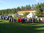 View larger image of Campers sitting at picnic tables at CROOKED CREEK RESORT  RV PARK image #6