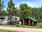 View larger image of RV and log cabin at CROOKED CREEK RESORT  RV PARK image #9