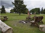 View larger image of Trailers parked in gravel sites at GLOWING EMBERS RV PARK  TRAVEL CENTRE image #6