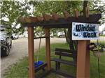 View larger image of RV sites framed by hanging flower pots at GLOWING EMBERS RV PARK  TRAVEL CENTRE image #9