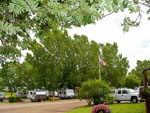 View larger image of Flag pole at campgrounds at GLOWING EMBERS RV PARK  TRAVEL CENTRE image #11