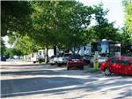 View larger image of Various vehicles parked besides trailers along road at COUNCIL ROAD RV PARK image #9