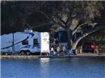 View larger image of A RV site alongside some water at SANTEE LAKES RECREATION PRESERVE image #8