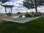 View larger image of A hammock on the grass at SILVER STATE RV PARK image #1