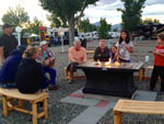 View larger image of People sitting around a fire pit at SILVER STATE RV PARK image #2