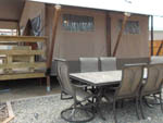 View larger image of Large tent with seating area and table at SILVER STATE RV PARK image #6