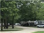 View larger image of Man and boy fishing on the dock at RIVERVIEW RV PARK image #2