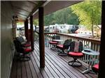View larger image of Chairs on the deck overlooking the park at LAKESIDE RV CAMPGROUND image #9