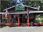 View larger image of Rustic park office with porch at BEAR PAW CAMPER PARK image #3